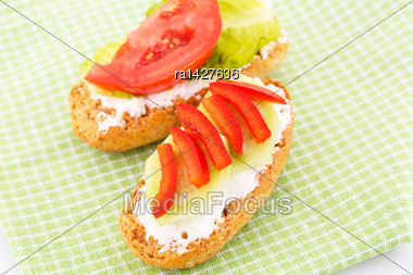 Sandwiches With Rusks, Vegetables, Cheese On Green Towel Stock Photo