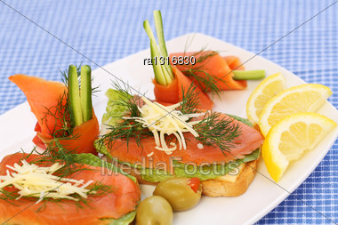 Sandwiches With Salmon, Cheese, Lettuce, Herbs On Plate, Olives And Lemons Stock Photo