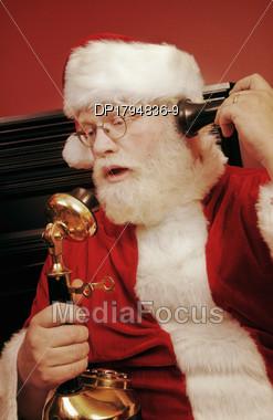 Santa Talking On The Phone Stock Photo