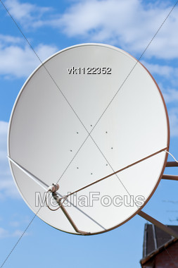 sattelite dish on blue sky background Stock Photo