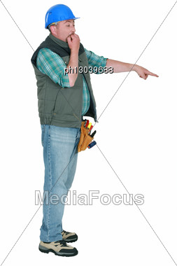 Scared Builder Biting Nails And Pointing Stock Photo