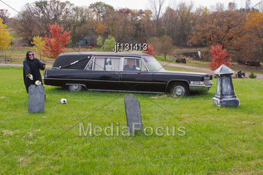 Scary Halloween Decorations Of A Hearse And Grave Site At The Farm Stock Photo