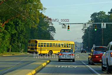 School Bus Turning Corner Stock Photo