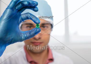Scientist with Gel Capsule Stock Photo