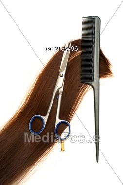 Scissors Hairbrush And Lock Of Hair Stock Photo