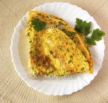 Scrambled Eggs With Herbs. Omelet On White Plate Stock Photo
