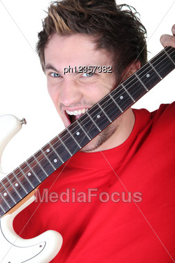 Screaming Man With Guitar In Hands Stock Photo