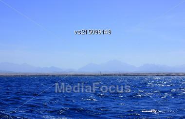 Sea Blue Water Background At Sun Light Stock Photo