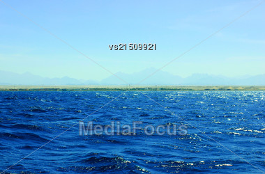 Sea Blue Water Background At Sun Light Stock Photo