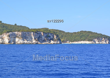 Sea Rocky Coast Overgrown With The Wood Stock Photo