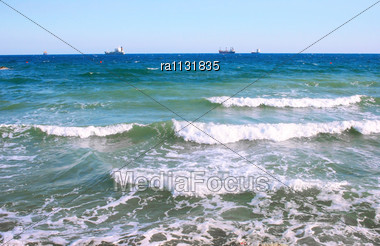 Sea Waves And Ships Stock Photo