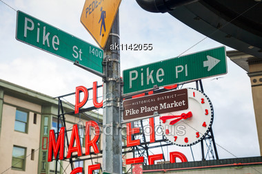 SEATTLE - MAY 9: Famous Pike Place Market Street Sign On May 9, 2014 In Seattle, WA. The Market Opened In 1907, And Is One Of The Oldest Continuously Operated Public Farmers' Markets In The US Stock Photo