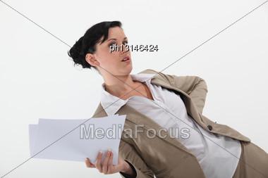 Secretary Holding Paperwork Stock Photo