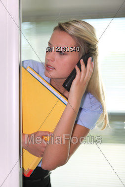 Secretary Talking On The Phone Stock Photo