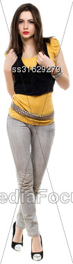 Seductive Brunette Wearing Grey Jeans, Yellow T-short And Black Vest. Isolated On White Stock Photo