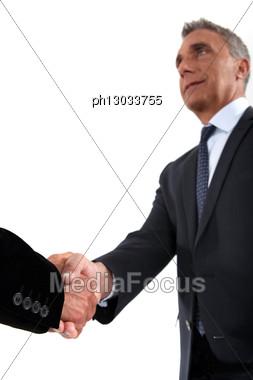 Senior Businessman Shaking Hands Stock Photo