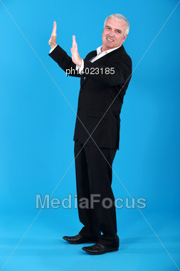 Senior Businessman Under Pressure Stock Photo