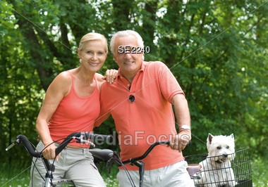 Senior Couple Biking Stock Photo