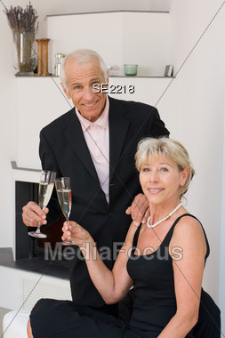 Senior Couple Celebrating Stock Photo
