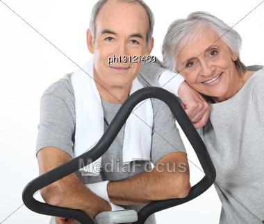Senior Couple Doing Exercises In The Gym Stock Photo