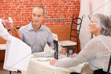 Senior Couple Having A Romantic Meal Stock Photo