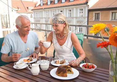 Senior Couple Having Coffee and Cake Stock Photo