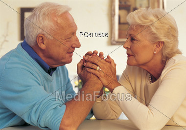 Senior Couple Holding Hands, Support Stock Photo