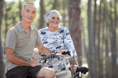 Senior Couple On A Bicycle Stock Photo
