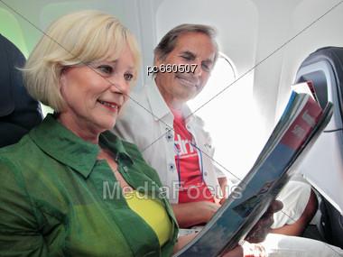 Senior Couple On The Plane Stock Photo