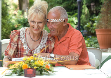 Senior Couple Reading Menu at Restaurant Stock Photo