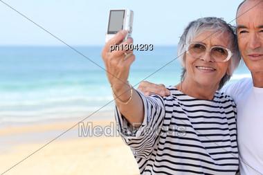Senior Couple Taking A Photo Stock Photo