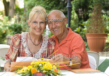 Senior Couple with Menus at Restaurant Stock Photo