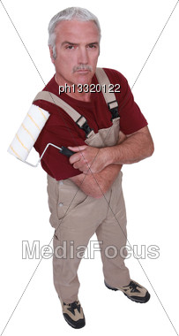 Senior Handyman Holding Paint Roller Stock Photo
