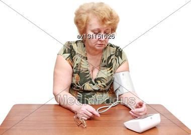 Senior Lady Measures Arterial Pressure , Use Digital Tonometer . Isolated Stock Photo