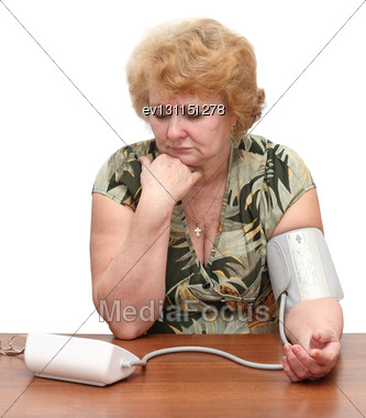 Senior Lady Measures Arterial Pressure , Use Digital Tonometer . Isolated. Upset By Instrument Readings Stock Photo