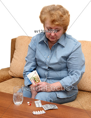 Senior Lady Woman With Medication Pills. Isolated Over White Stock Photo