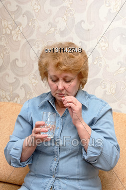 Senior Lady Woman With Medication Pills In Room Stock Photo