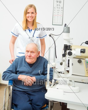 Senior Man With Alzheimer's Disease In Wheelchair At The Ophthalmology Stock Photo