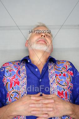 Senior Man Lying Stock Photo