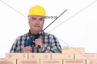 Senior Mason Holding Brick Drill Stock Photo