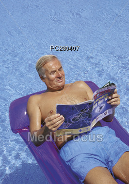 Senior Relaxing in Pool Stock Photo