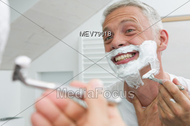 Senior Shaving Stock Photo