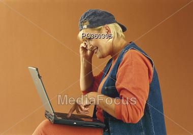 Senior Using Her Laptop Stock Photo