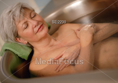 Senior Woman in Spa Stock Photo