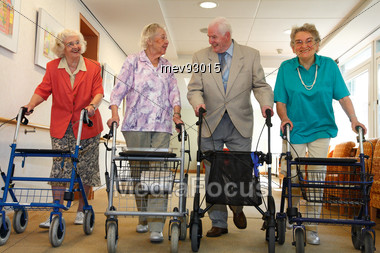 Seniors Walking With Walkers Stock Photo