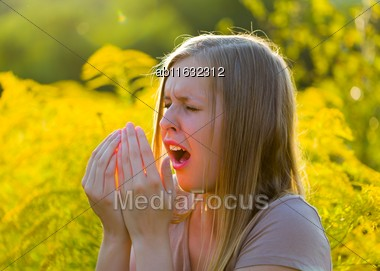 Sensitive Blond Woman Sneezing, Because Of Immune System With Allergy Stock Photo