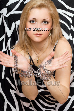 Sensual Beautiful Blonde Stretches Out Her Hands In Chains Stock Photo