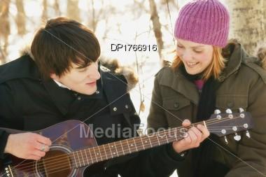 Serenading A Girl Stock Photo