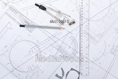 Serious Architect Plans, Compasses And Rulers Stock Photo