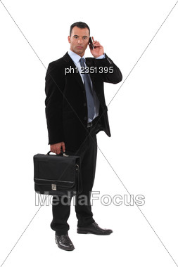 Serious Businessmen With A Cellphone Stock Photo